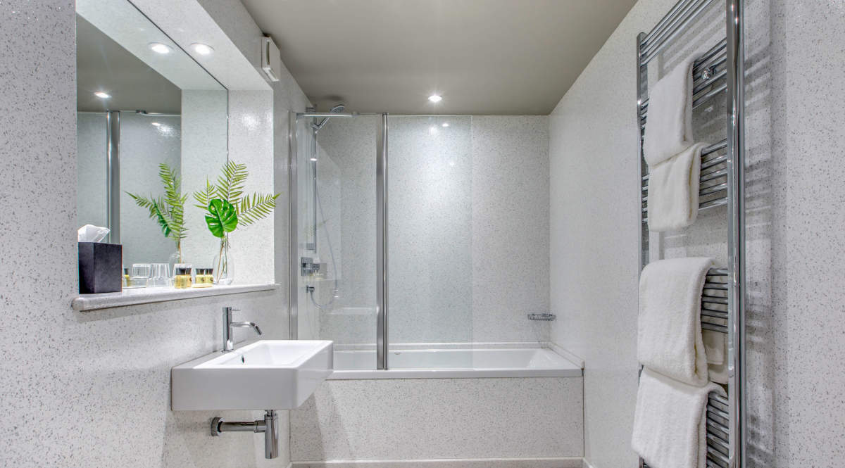 En-suite bathroom with shower and bath