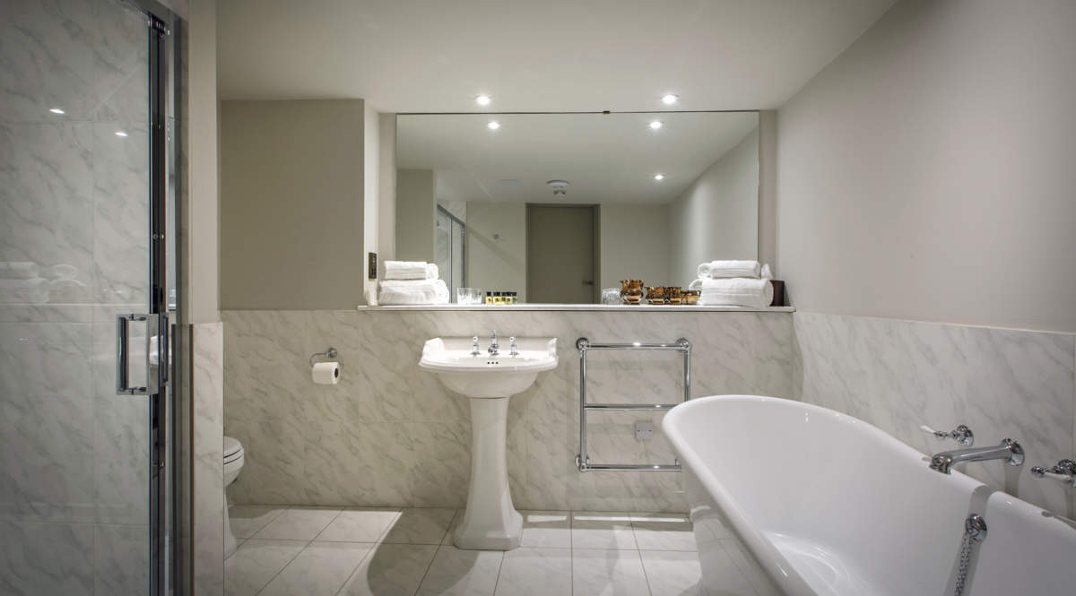 Room one en-suite featuring bath and shower